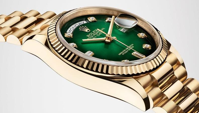 The 18ct gold copy watches have green dials.
